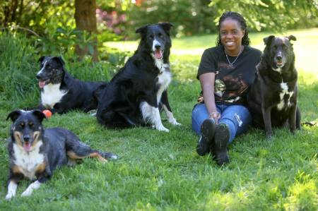 Dog Nutrition Blogger for Keep the Tail Wagging, Kimberly Gauthier, and her four dogs.